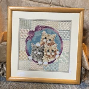 Cats on quilted background; needlepoint framed